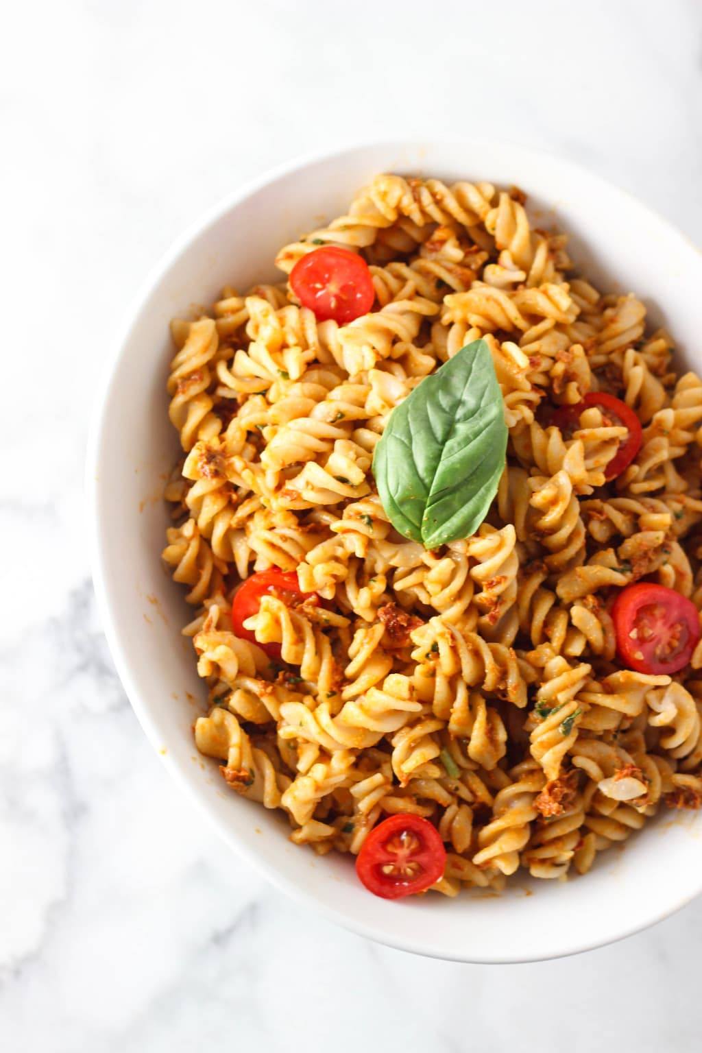 Vegan Sun Dried Tomato Pesto Pasta Dish that makes the perfect Summer dish! This recipe is vegan and gluten-free! Loaded with so many vitamins, minerals, antioxidants and more!