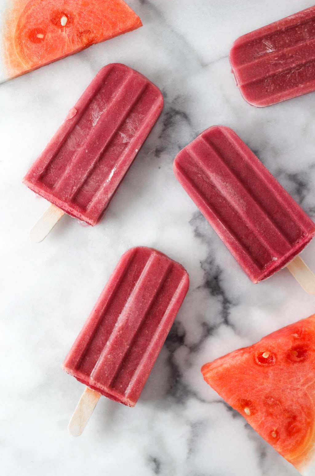 Cherry Watermelon Popsicle Recipe that is HEALTHY, EASY AND DELICIOUS! Super refreshing on a hot summer day! Make them today!