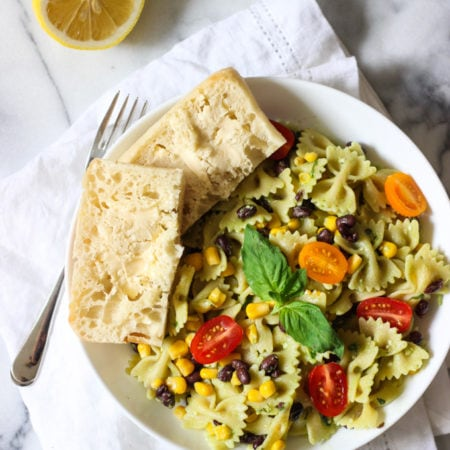 BOW TIE PASTA SALAD WITH AVOCADO PESTO makes the perfect lunch! Loaded with good carbs, beans, whole grains and more! Great vegetarian/vegan recipe!