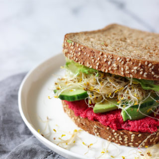 Beet Hummus Sandwich makes the perfect healthy lunch! Loaded with protein, fibre and vegetables! Great to pack for lunch or school!
