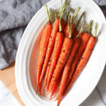 "Holiday Garlic Roasted Carrots Recipe makes the perfect healthy side to any dish! Vegan recipe that everyone will love! The stems on the carrots make this side a great holiday ""fancy"" side as well! Exploring Healthy Foods"