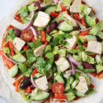Loaded Chicken Greek Salad Pizza Recipe. Easy & Healthy dinner idea that is filling and loaded with flavour! Paleo and dairy-free